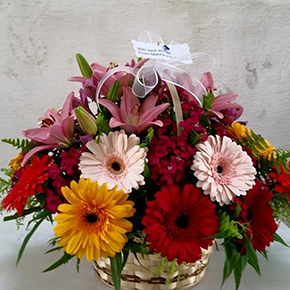 9 red rose bouquet Lilies and gerberas in a basket.