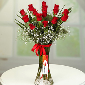 11 red roses in white box 15 red roses in a vase